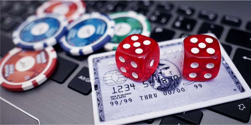 Poker chips and cards on a bank card; JackpotCity Casino Blog
